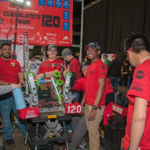 The students from team 120 are working on their robot.