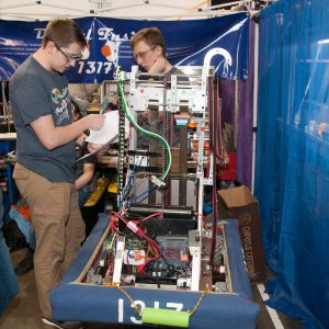 The students from team 1317 work on their robot.