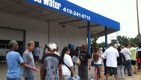 Residents of Toledo, Ohio, line up for water on Saturday, Aug. 2, 2014