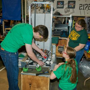 Students from team 2172 work on their robot