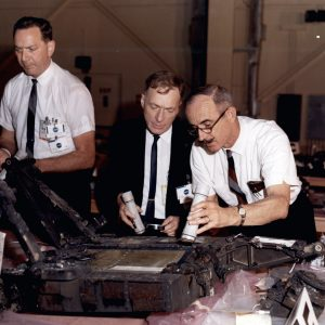 Men examining equipment