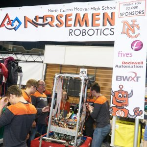 Another photo of team 4121 showing the students working on their robot in the pit area.