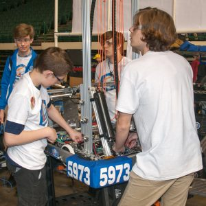 The students from team 5973 working on their robot.