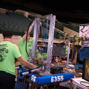 Students from team 6355 (Robots over Parma) working on their robot.