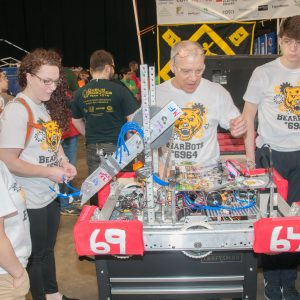 The students from team 6964 working on their robot.