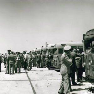 People boarding buses.