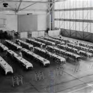 Banquet tables in hangar.