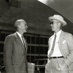 Two men in front of Hangar.