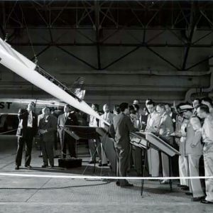 Group examining model aircraft.