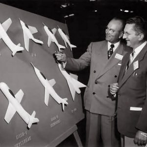 Two men with model aircraft display.