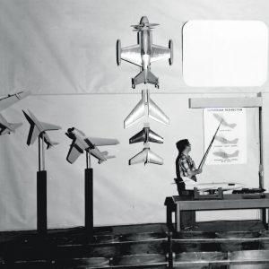 Man with aircraft models.
