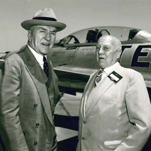 Two men beside aircraft.
