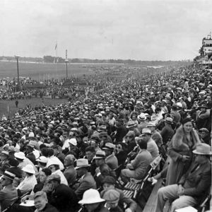 Crowd in outdoor grandstands.