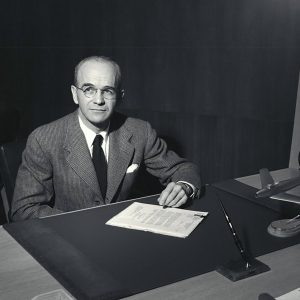 Russell Robinson at desk.