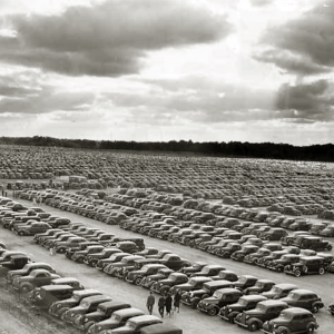 Rows of cars in 1938 parking lot.
