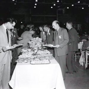 Men at banquet table.