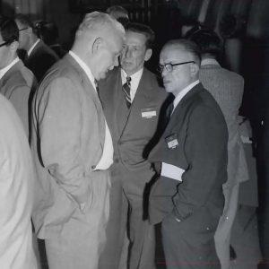 Group of men talking.