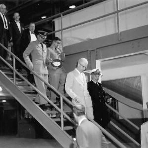 Men descending stairs.