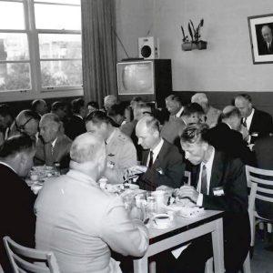 Group of men having lunch.