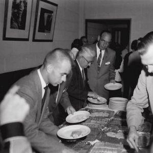 Men in lunch line.