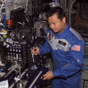 ISS Commander and Science Officer, Leroy Chiao performing BCAT-3 operations.