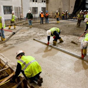 Workers laying concrete at the Space Power Facility.
