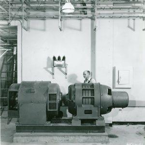 Man with compressor unit.