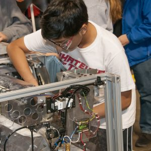 A student works on his team's robot in the pits at the Buckeye Regional.