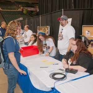 A student asks a question at the Pit Administration table.