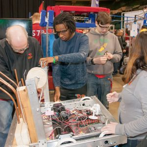 Students work on their robot in the pits area at the Buckeye Regional.