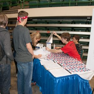 Safety is top priority at the B uckeye Regional - A student signs out a pair of safety glasses before entering the pits area at the Buckeye Regional.