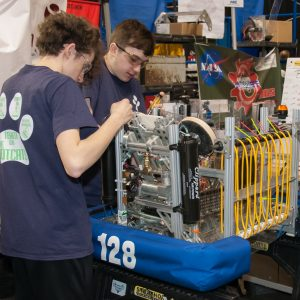Students from team 128 works on their robot in the pits area at the Buckeye Regional.