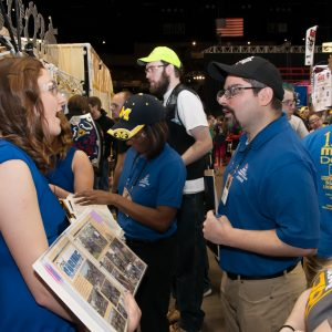 One of the teams talk to several Buckeye Regional judges and show them pictures from their robotics team.