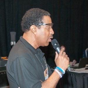 The game announcer keeping the audience informed during the competition at the Buckeye Regional.