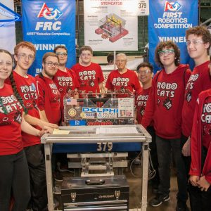The students from team 379 (RoboCats) take a breat from working on their robot to pose for the camera.