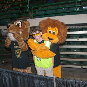 Team mascots from two teams competing at the Buckeye Regional. Mr. lion has his arms around one of the team members - Oh Oh!