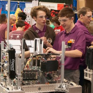Students from one of the robotics teams competiting at the Buckeye Regional working on their robot.