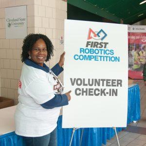 One of the volunteers at the volunteer check-in table welcomes all volunteers to the 2017 Buckeye Regional.