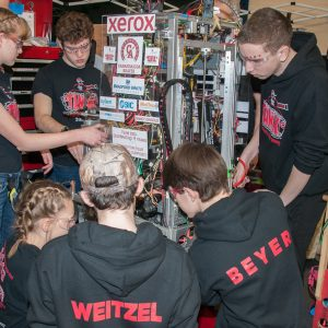 The students from team 3003 work on their robot in the pits area at the 2019 Buckeye Regionl Robotics Competition.