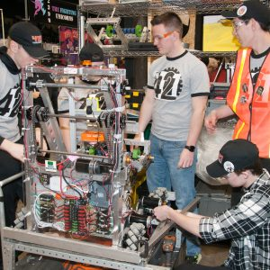 The students from team 4121 work on their robot in the pits area at the 2019 Buckeye Regionl Robotics Competition.