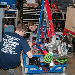 The students from team 3193 work on their robot in the pits area at the 2019 Buckeye Regionl Robotics Competition.