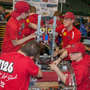 The students from team 1126 work on their robot in the pits area at the 2019 Buckeye Regionl Robotics Competition.