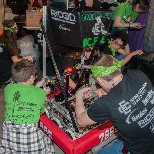 The students from team 7885 work on their robot in the pits area at the 2019 Buckeye Regionl Robotics Competition.
