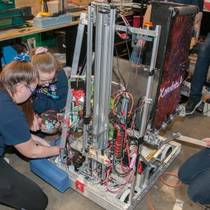 The students from team 2340 work on their robot in the pits area at the 2019 Buckeye Regionl Robotics Competition.