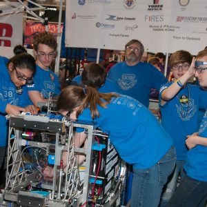 The students from team 6936 work on their robot in the pits area at the 2019 Buckeye Regionl Robotics Competition.
