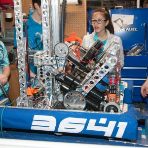 The students from team 3641 work on their robot in the pits area at the 2019 Buckeye Regionl Robotics Competition.