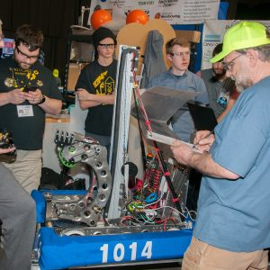 A Robot Inspector checks team 1014's robot to assure it was built according to the rules of this year's competition.