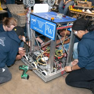 The students from team 6870 work on their robot in the pits area at the 2019 Buckeye Regionl Robotics Competition.