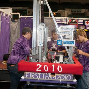 The students from team 2010 work on their robot in the pits area at the 2019 Buckeye Regionl Robotics Competition.