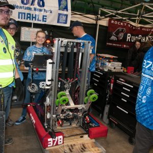 The students from team 378 work on their robot in the pits area at the 2019 Buckeye Regionl Robotics Competition.